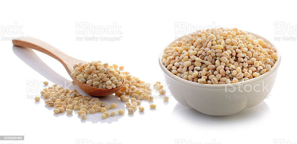 Job's tear seed in the white bowl on white background stock photo