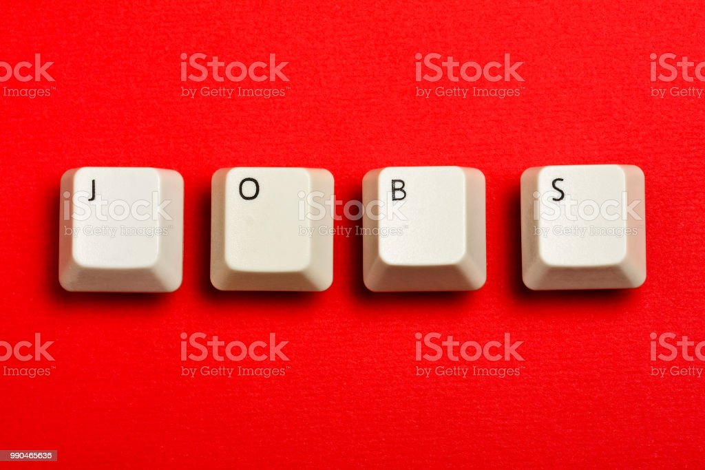 jobs text formed with real white keyboard keys on red stock photo