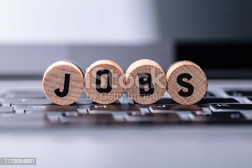Close-up Of Jobs Text On Wooden Blocks Over Keyboard In Office