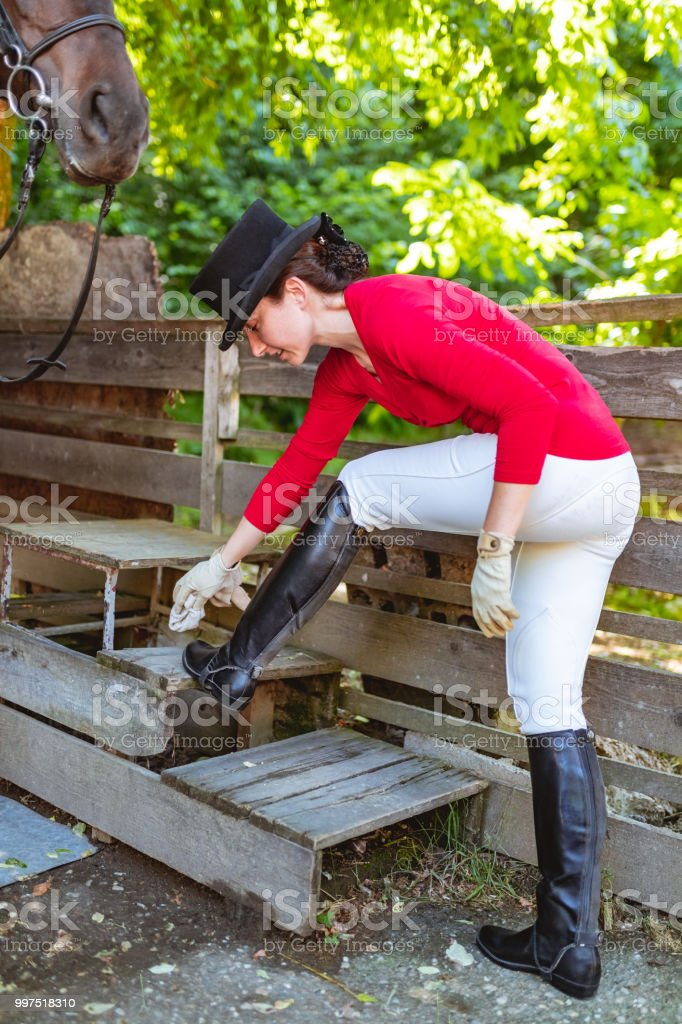 Cleaning Essentials: Jockey Cleaning Riding Boots Stock Photo