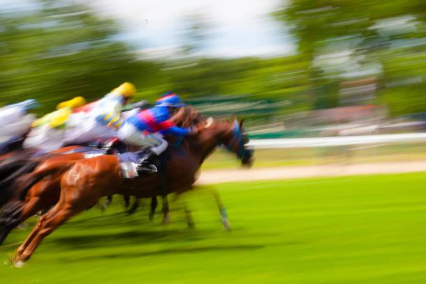 Jockey horsing stock photo