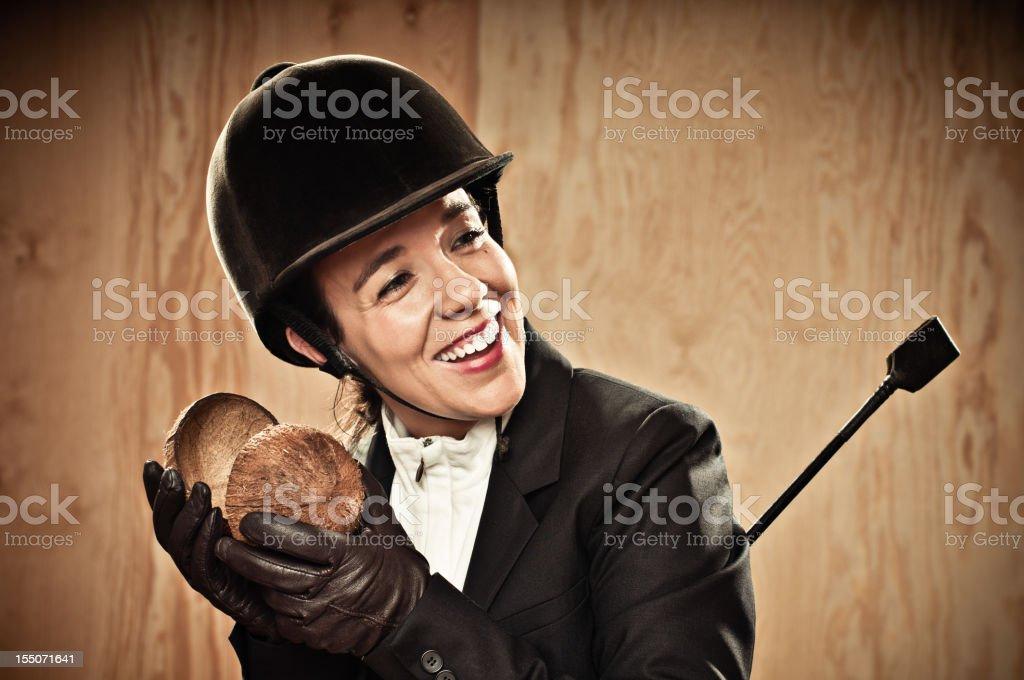 Jockey playing the coconut stock photo