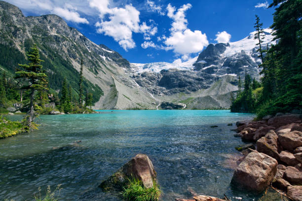 Joffre Lakes in summer, BC, Canada Upper Joffre Lake in summer in Pemberton, BC, Canada british columbia stock pictures, royalty-free photos & images