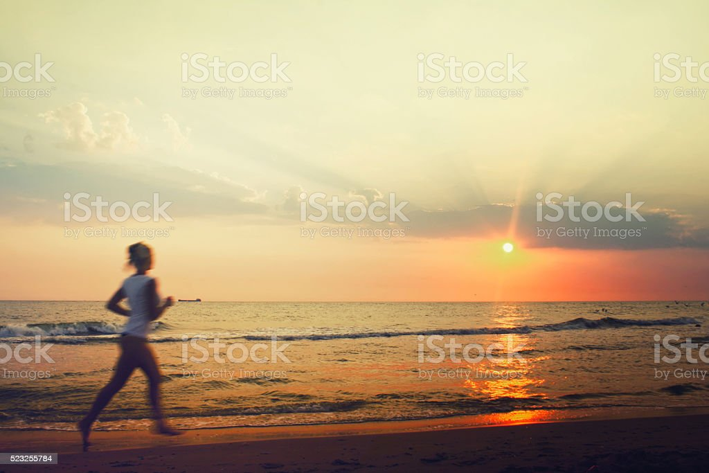Jog on the beach stock photo