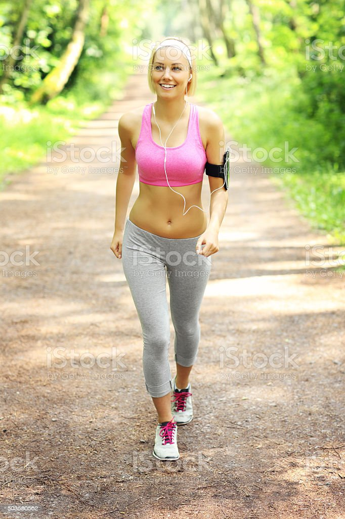 Jogger in the forest stock photo