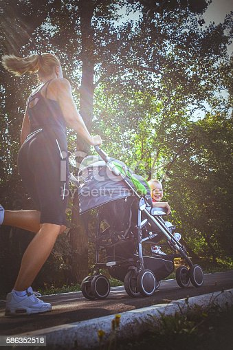 istock Jogger mom with baby in stroller 586352518