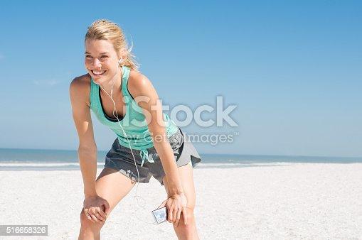 istock Jogger resting at beach 516658326