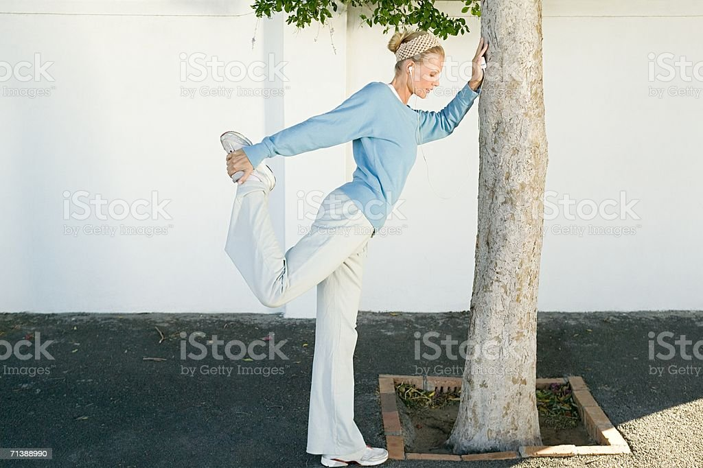 Jogger stretching her leg royalty-free stock photo