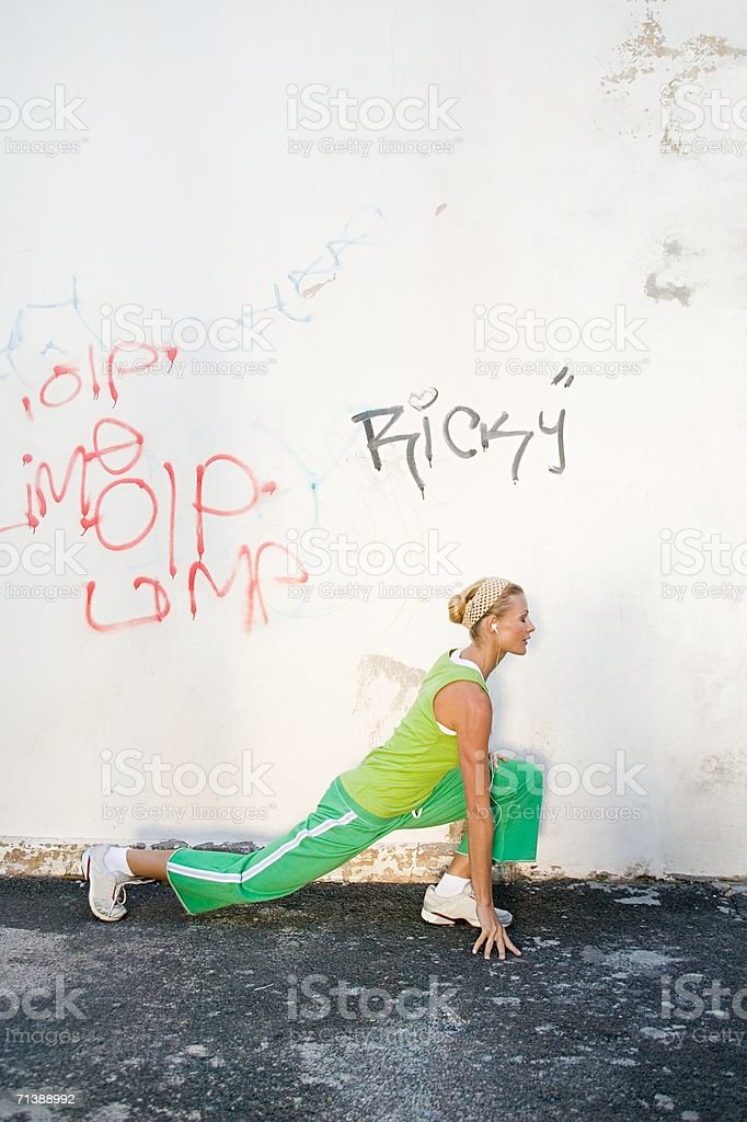 Jogger stretching royalty-free stock photo