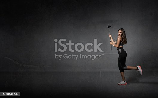 629605142istockphoto jogger taking selfie with phone 629605312