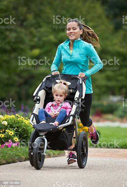 Jogger with baby jogger running on paved trail picture id488104465?b=1&k=6&m=488104465&s=612x612&h=xysoamzzw g9goyeiplc v1wme lhgupw38jle7fgyq=