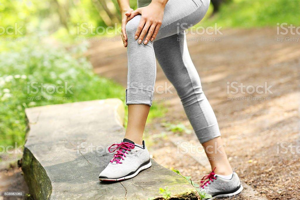 Jogger with hurt knee stock photo