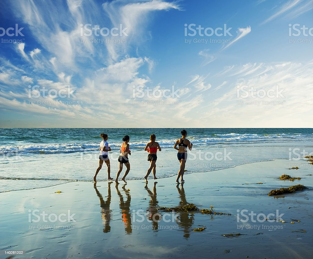 jogging along the surf royalty-free stock photo
