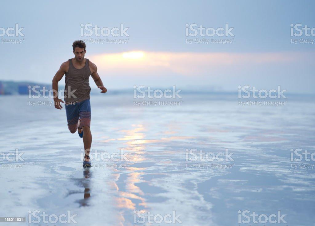 Jogging as the sun rises stock photo