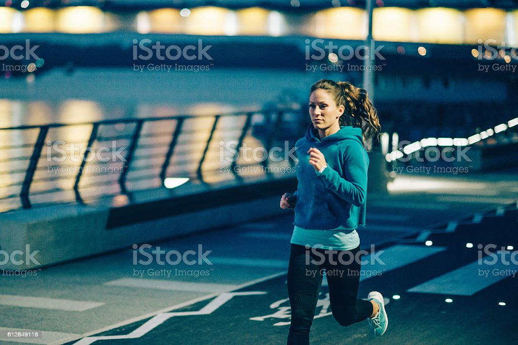 Jogging at night stock photo