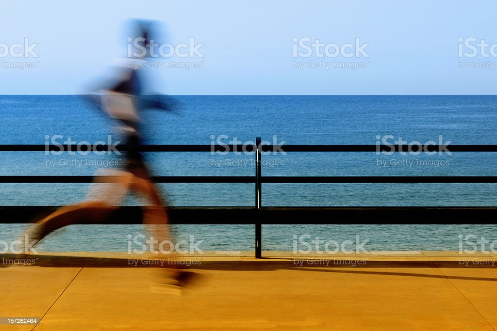 Jogging by the beach royalty-free stock photo