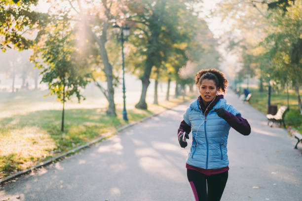 Jogging in autumn park stock photo