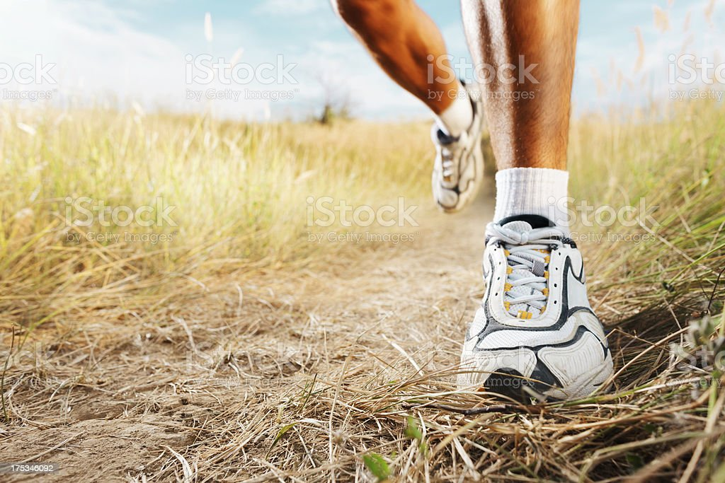 Jogging in nature, close-up shot of foot royalty-free stock photo