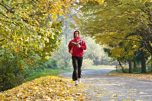 jogging in park - young singles stock photos and pictures