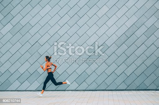 Beautiful young woman jogging in the city.