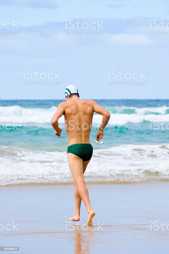 Jogging into the Surf stock photo