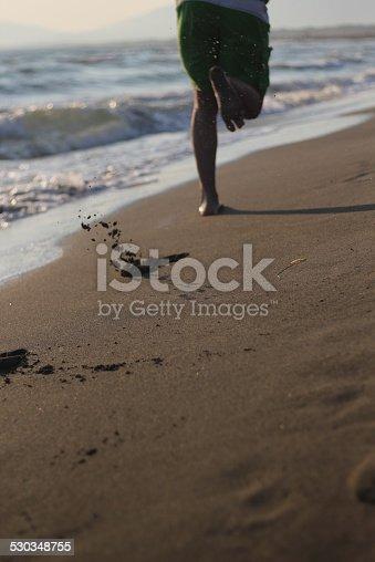 istock Jogging on beach 530348755