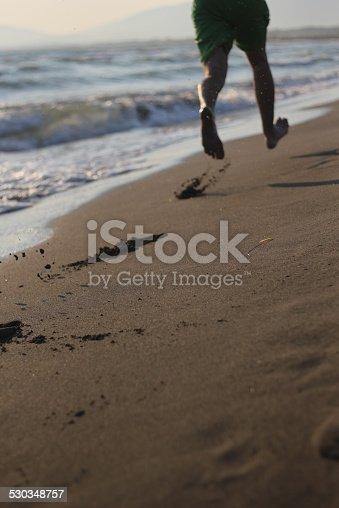 istock Jogging on beach 530348757