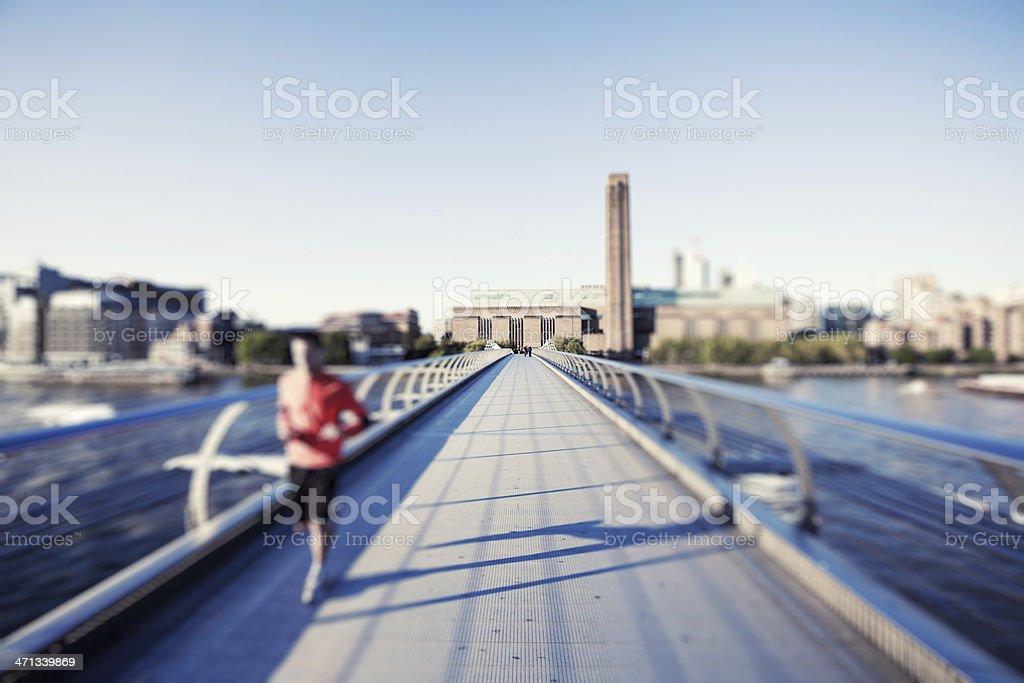 Jogging on London Millennium Bridge stock photo