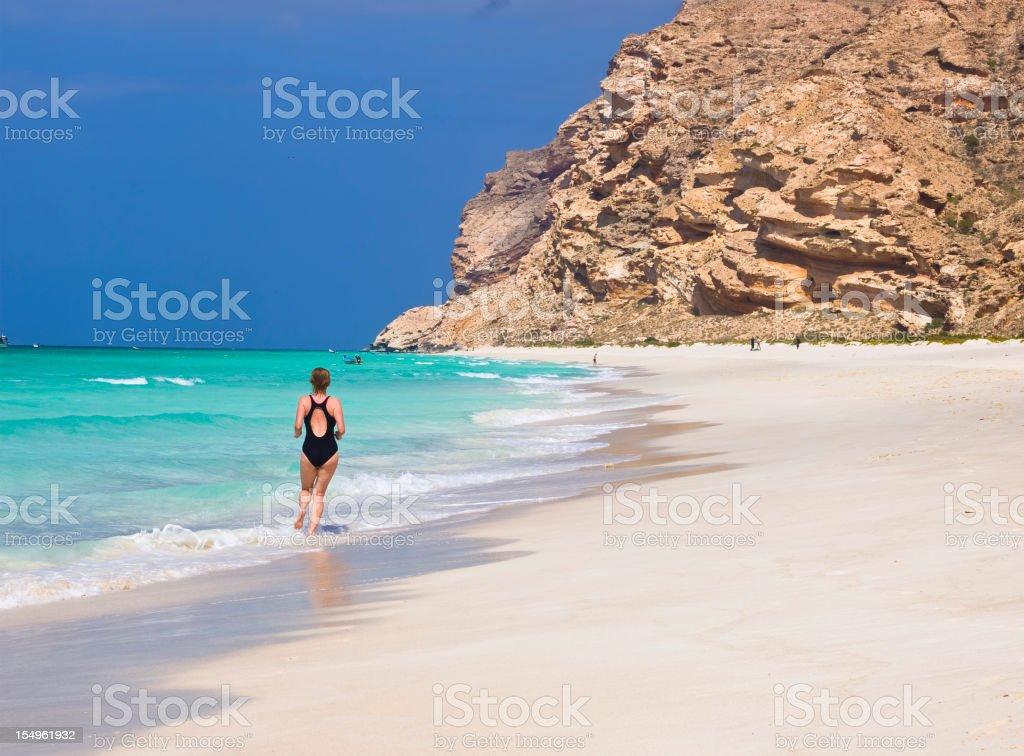 Jogging on Shouab beach stock photo