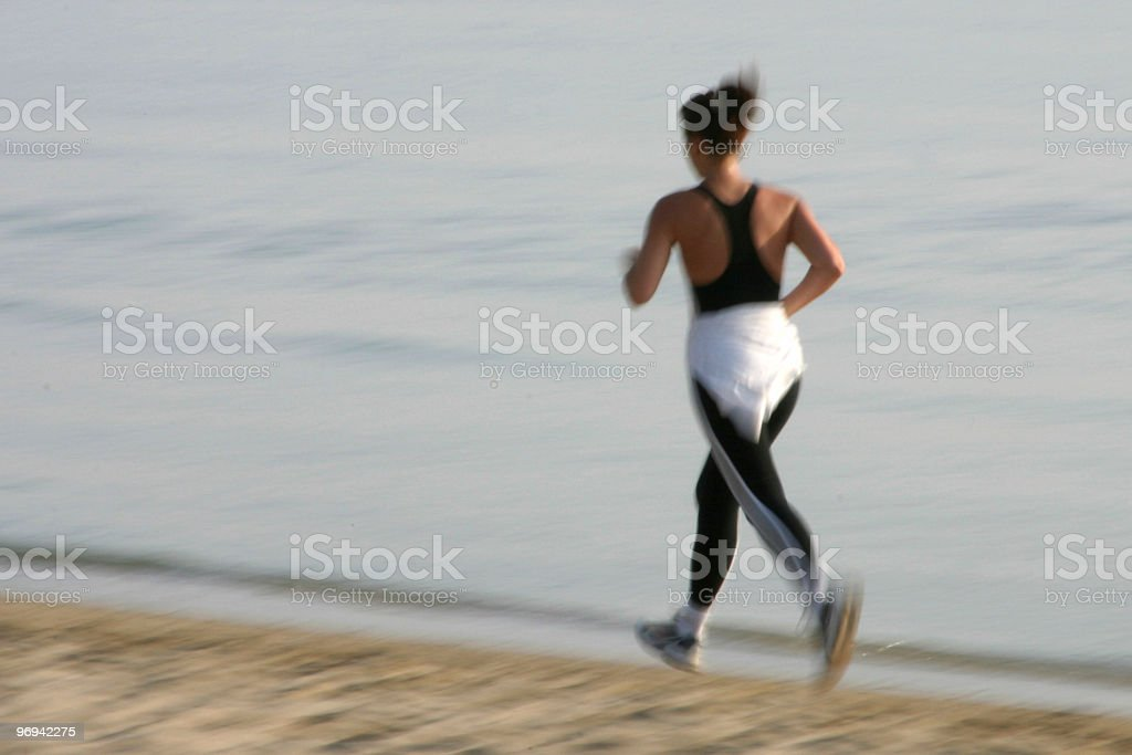 jogging on the beach 3 stock photo