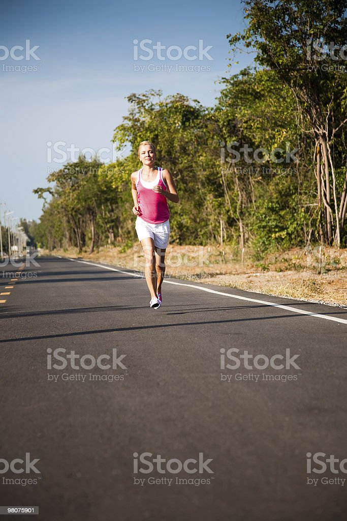 Jogging on the road royalty-free stock photo