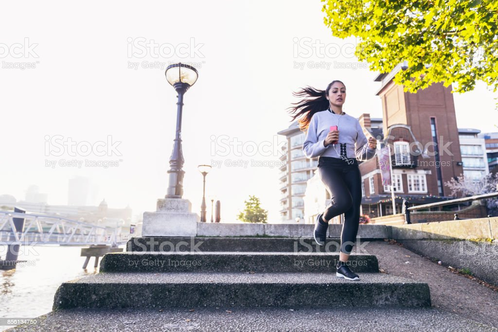Jogging Up And Down The Steps To Keep Rhythm With The Music