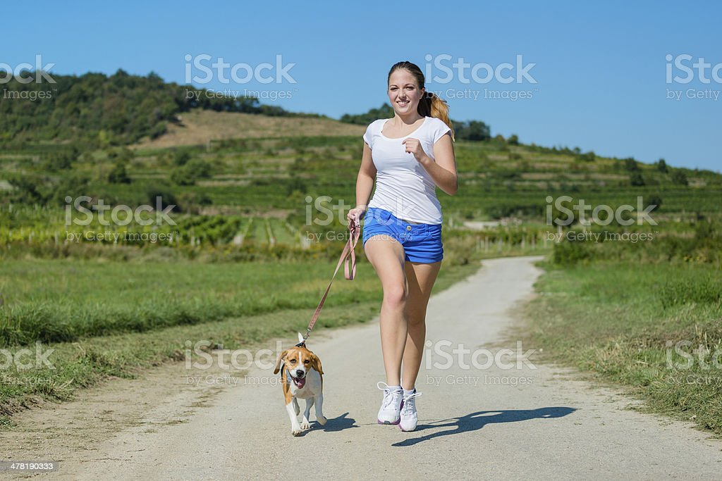 Jogging with animal friend royalty-free stock photo