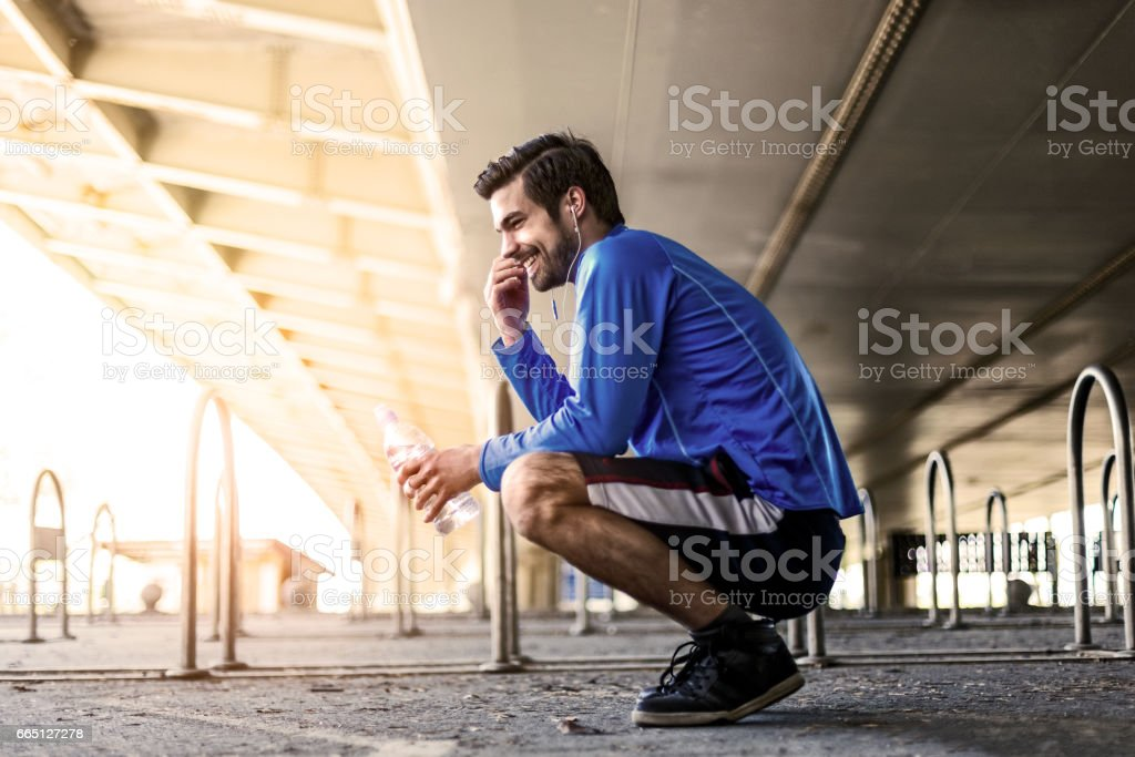 Jogging with favorite music track stock photo