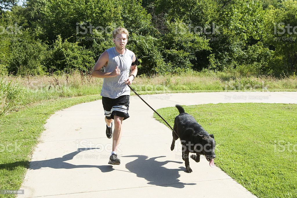 Jogging with his dog royalty-free stock photo