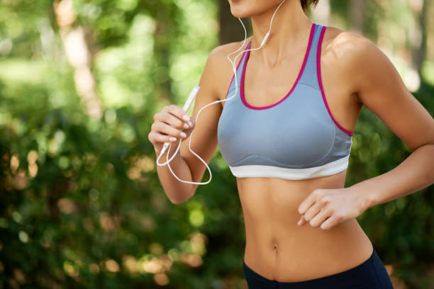 jogging workout - midsection stock pictures, royalty-free photos & images