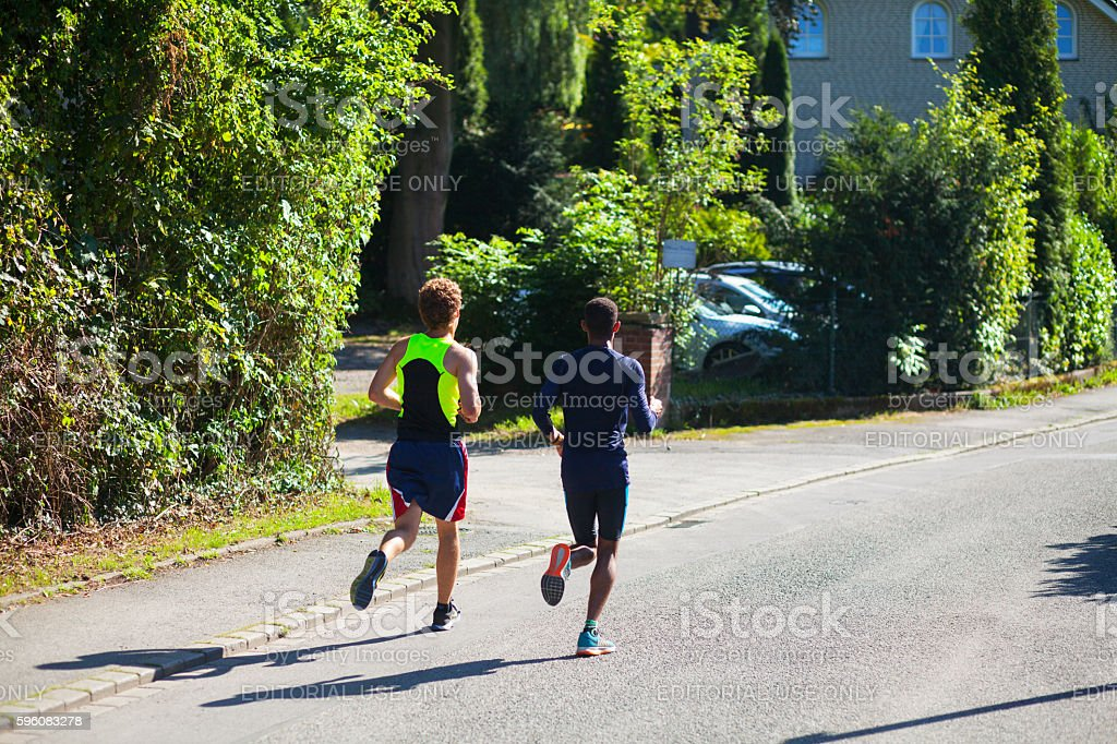 Jogging young men royalty-free stock photo