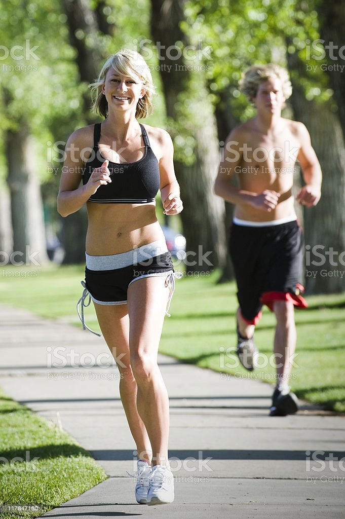 Jogging Young Woman and Man royalty-free stock photo