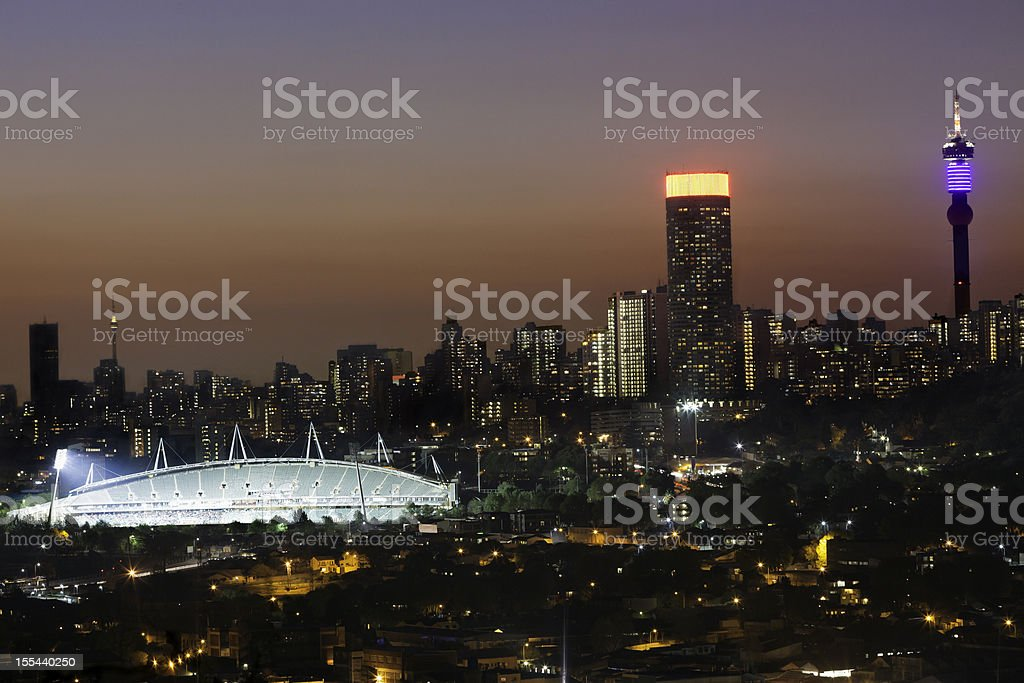 Johannesburg City and Stadium in the evening stock photo