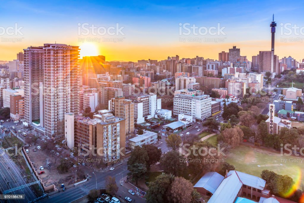 Johannesburg city panorama sunflare with the tower stock photo