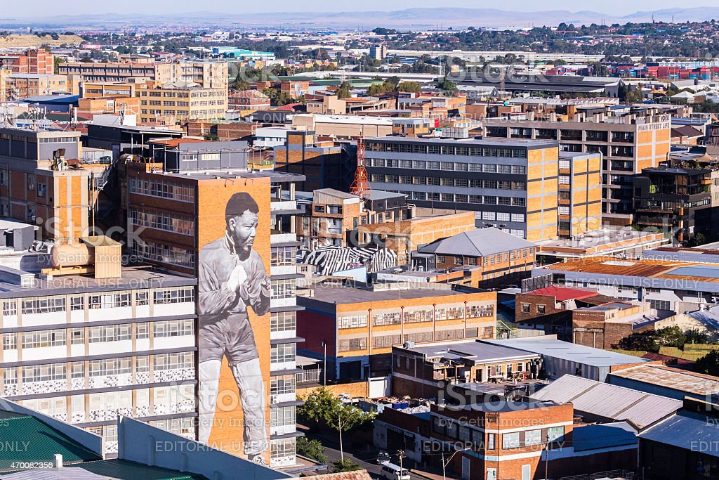 Johannesburg city with a murial of Nelson Mandela the boxer. stock photo
