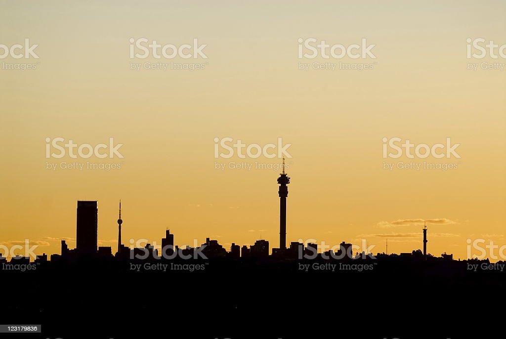 Johannesburg Skyline Silhouette at Sunset stock photo