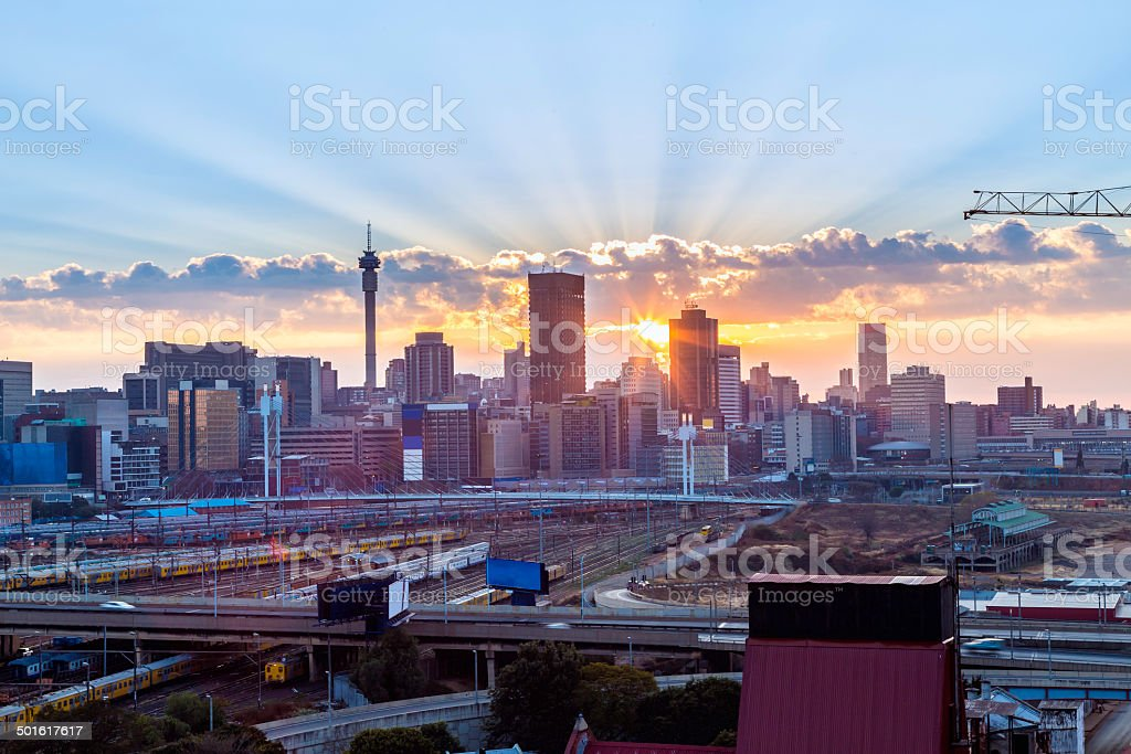Johannesburg sunrise sunburst stock photo