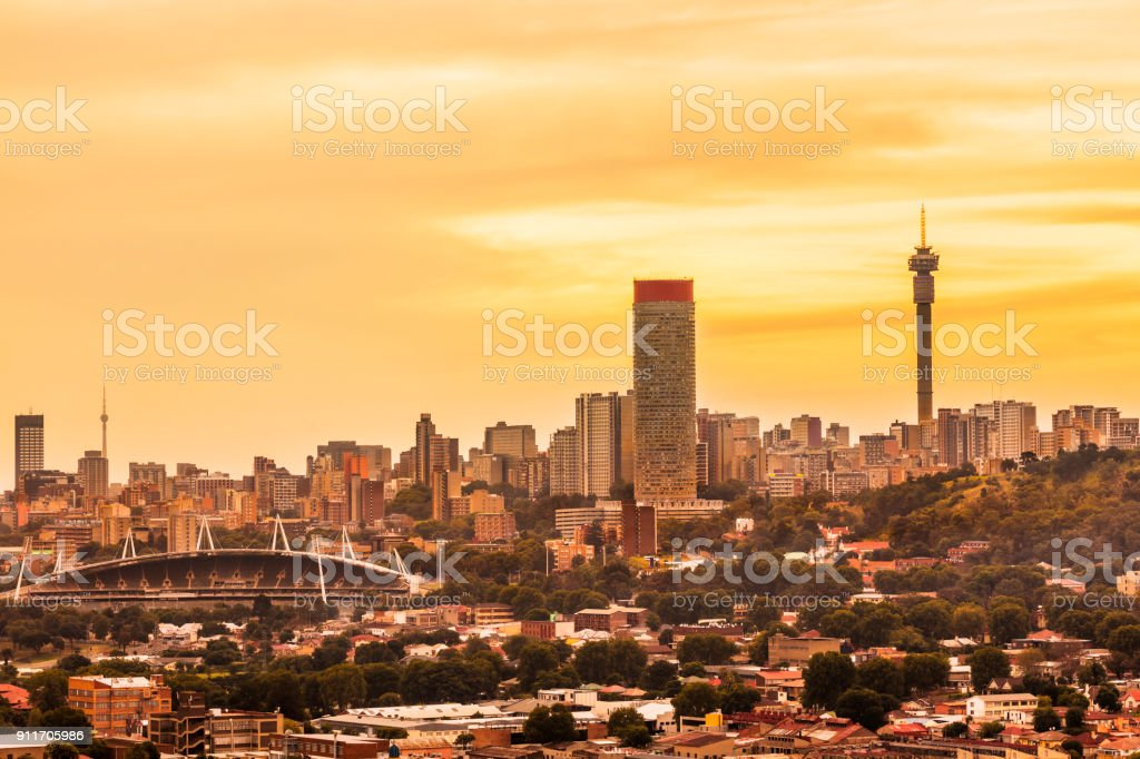 Johannesburg sunset cityscape with cloudscape stock photo