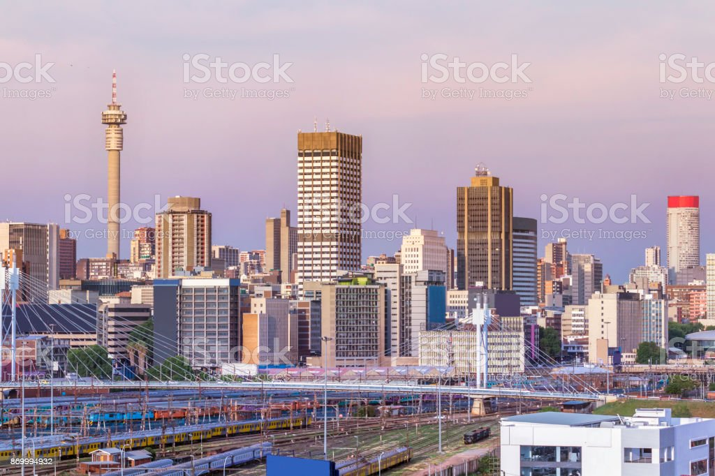 Johannesburg sunset cityscape with Nelson Mandela Bridge stock photo