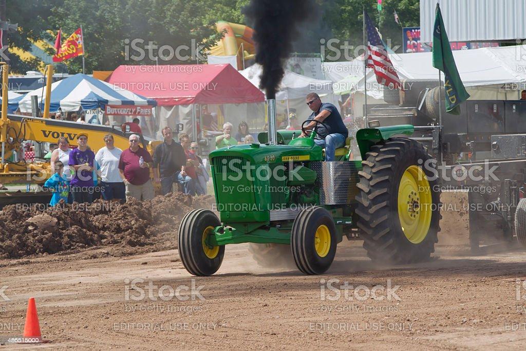 John Deere 6030 Tractor pulling stock photo