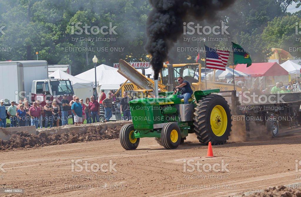 John Deere 6030 Tractor pulling with smoke stock photo