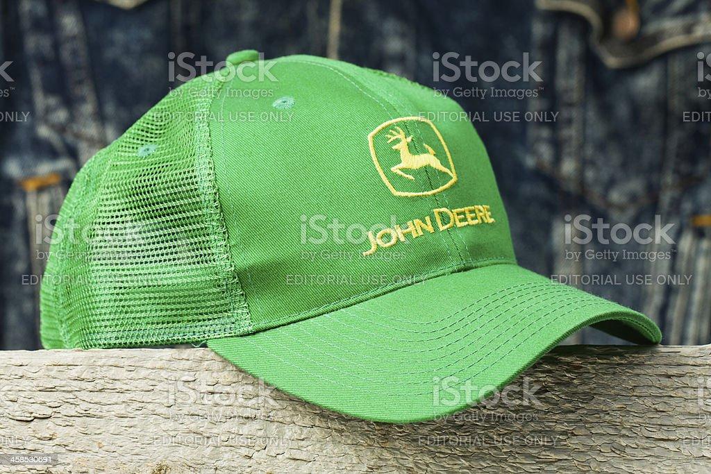 John Deere Cap on Wood Block stock photo