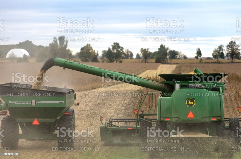 John Deere Combine Harvesting Soybeans stock photo