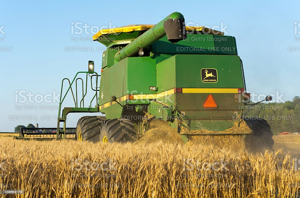 John Deere Combine In Wheat Field Royalty Free Stock Photo